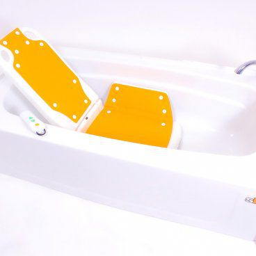 Bathlyft chair lowered into bathtub