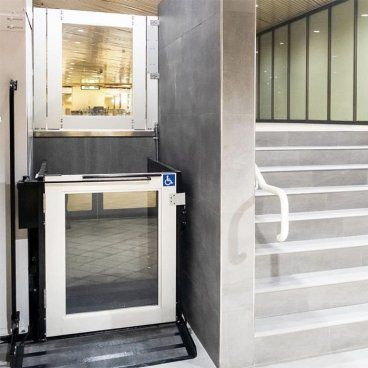 commercial platform lift with glass in doors